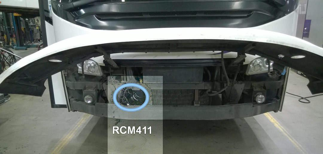 RCM411 sensor installed in front of a bus with the hinged grill opened